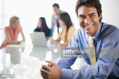Smiling businessman at meeting : Stock Photo