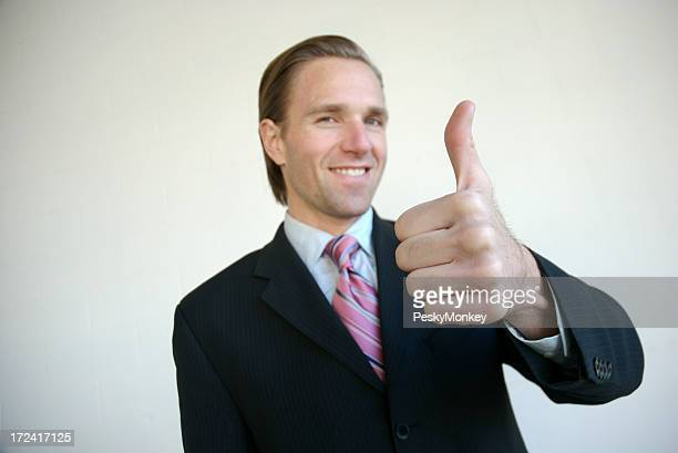 Smiling Businessman Giving Thumbs Up White Background