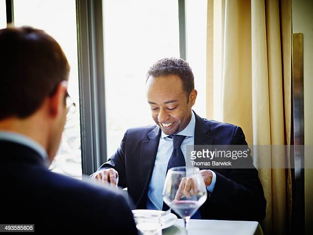 Smiling businessman having meeting over lunch
