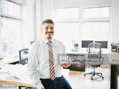 Smiling businessman holding digital tablet : Stock Photo