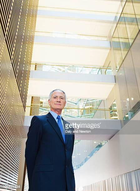 Smiling businessman in lobby