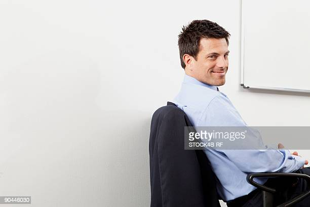Smiling businessman in office, Munich, Bavaria, Germany