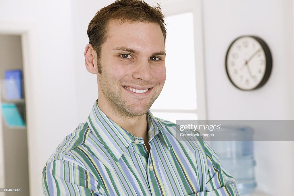 Smiling businessman in office : Stock Photo