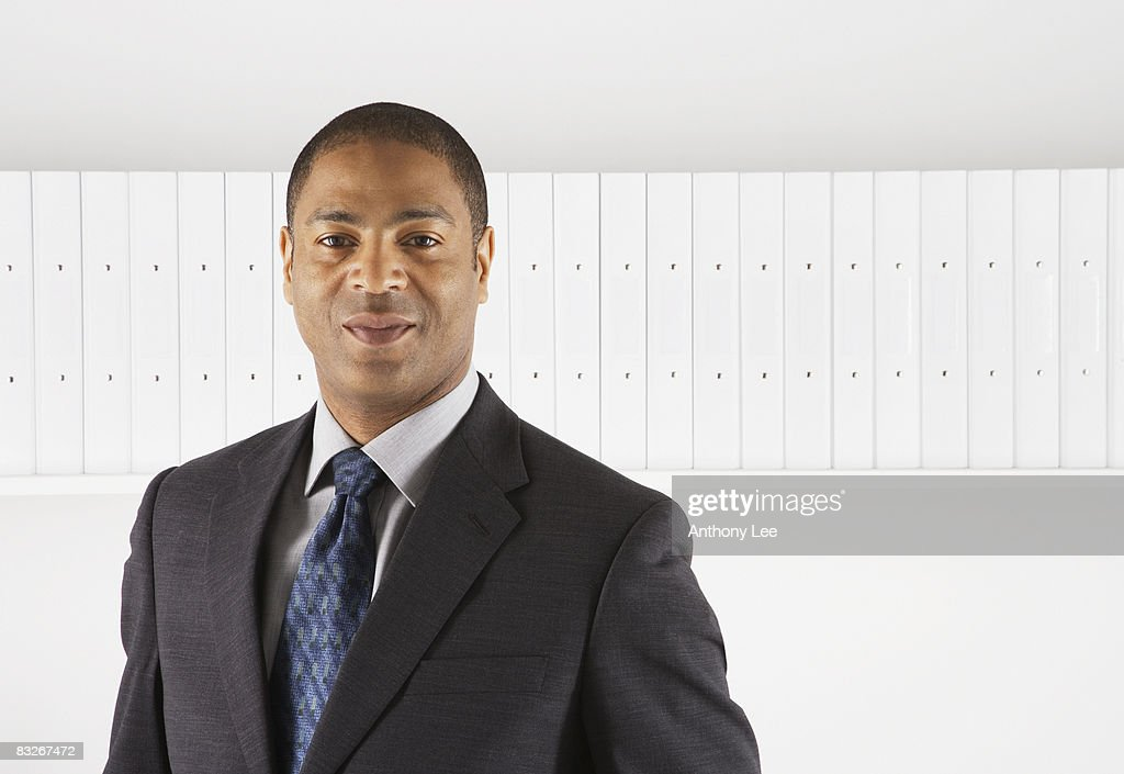 Smiling businessman in suit : Stock Photo