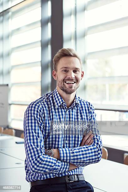 Smiling businessman in the office