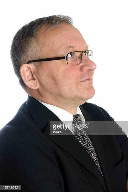 Smiling businessman looking up