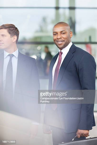 Smiling businessman outdoors