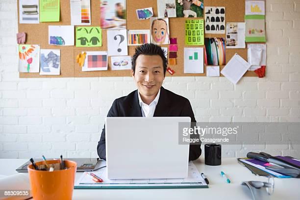 Smiling businessman sitting at desk
