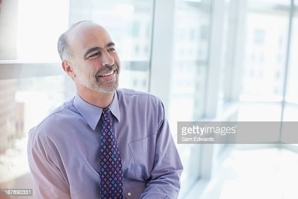 Smiling businessman sitting in office