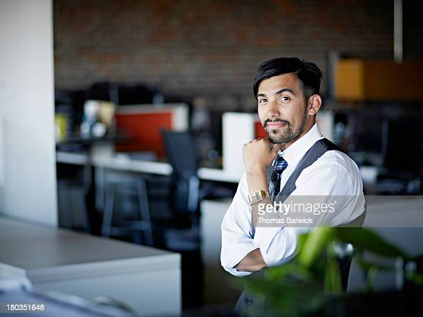 Smiling businessman standing in office