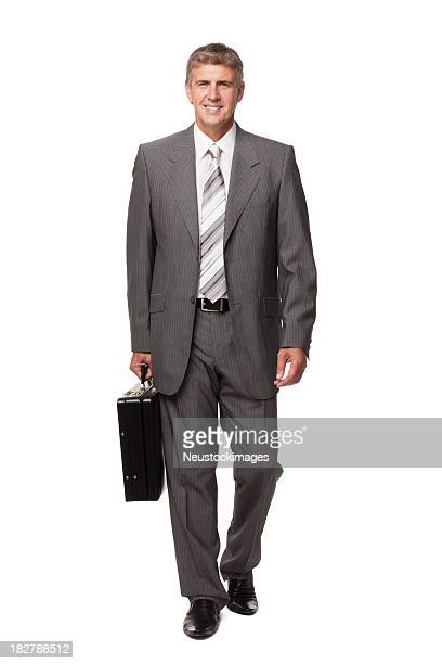 Smiling Businessman Walking With Briefcase. Isolated