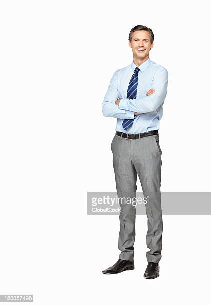 Smiling businessman with arms crossed against white background