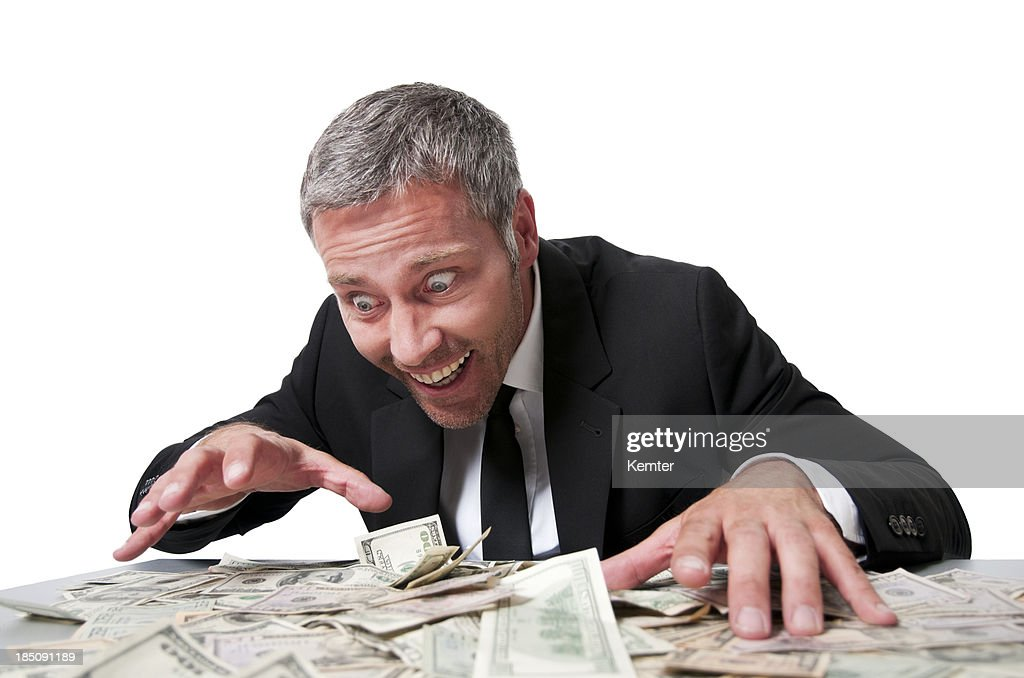 smiling man with many dollars
