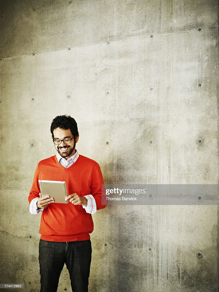Smiling businessman working on digital tablet : Stock Photo