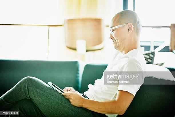 Smiling businessman working on digital tablet