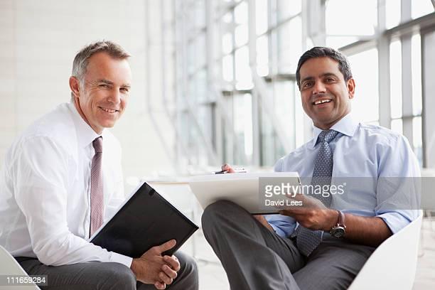 Smiling businessmen in meeting