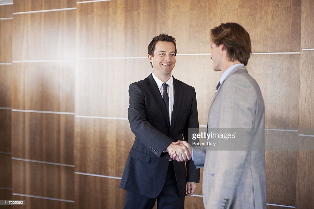 Smiling businessmen shaking hands : Stock Photo