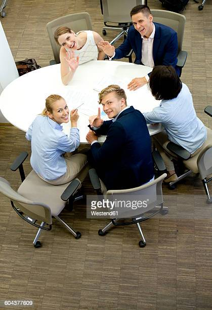 Smiling businesspeople having a meeting in office