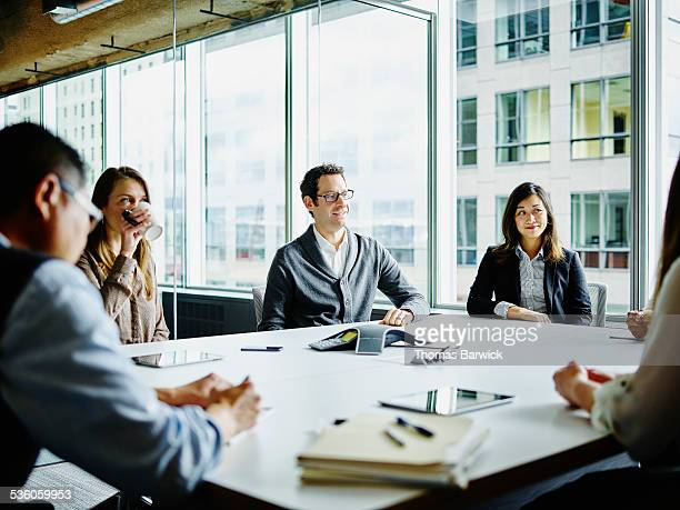 Smiling businesspeople meeting in conference room