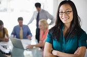 Smiling businesswoman at meeting