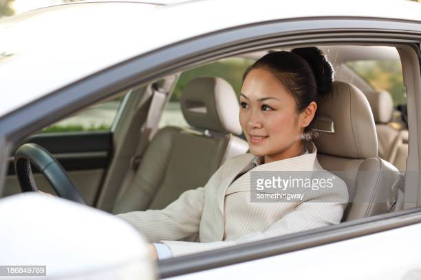 Smiling businesswoman drive a car