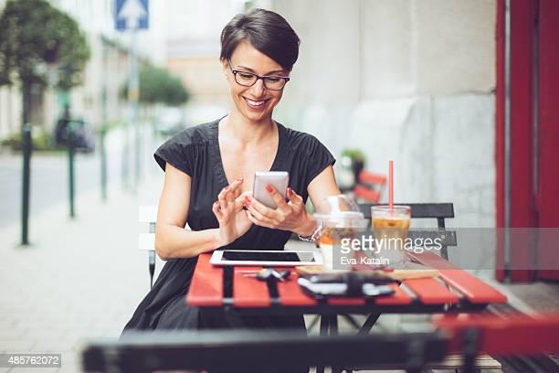 Smiling businesswoman having breakfast in a coffee shop