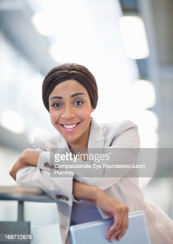Smiling businesswoman holding digital tablet : Stock Photo