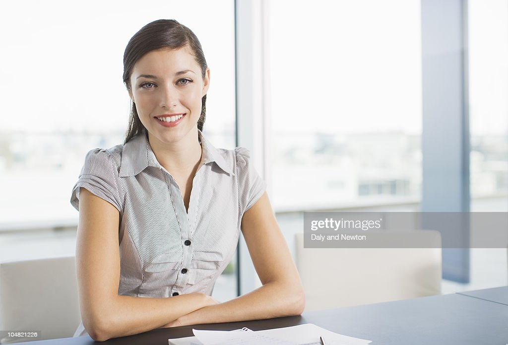 Smiling businesswoman in conference room : Stock Photo