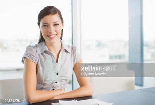 Smiling businesswoman in conference room : ストックフォト