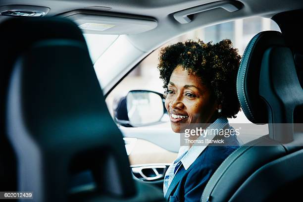 Smiling businesswoman in discussion in car