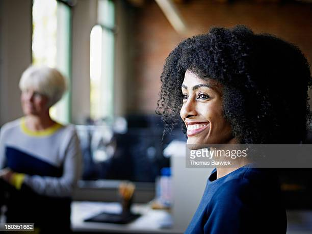 Smiling businesswoman in discussion in office