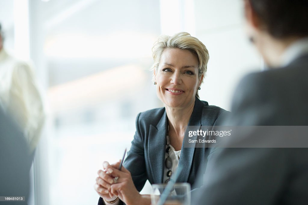 Smiling businesswoman in meeting : Stock Photo
