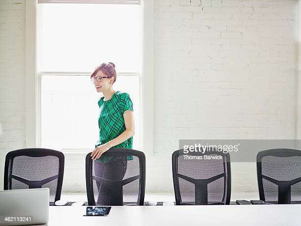 Smiling businesswoman in office conference room