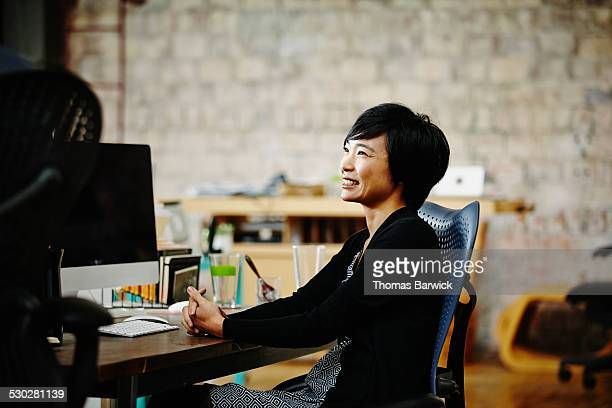 Smiling businesswoman in startup office