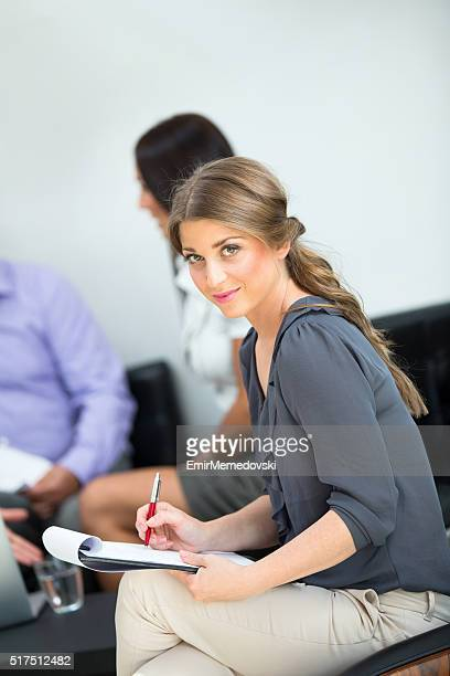Smiling businesswoman in the office.