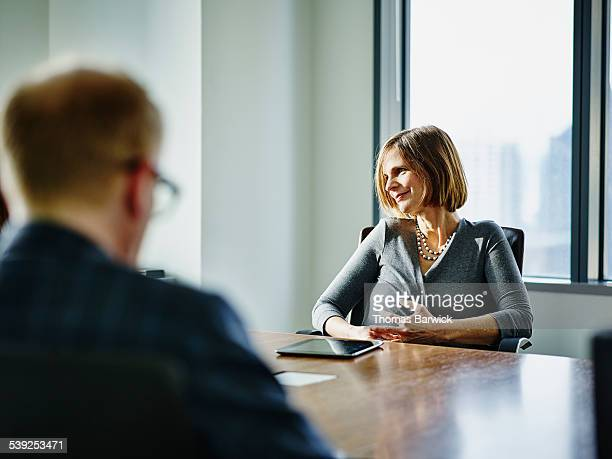 Smiling businesswoman listening during meeting