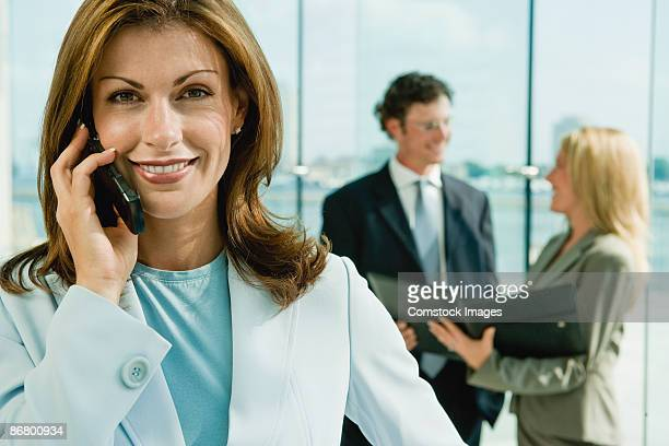 Smiling businesswoman on cell phone