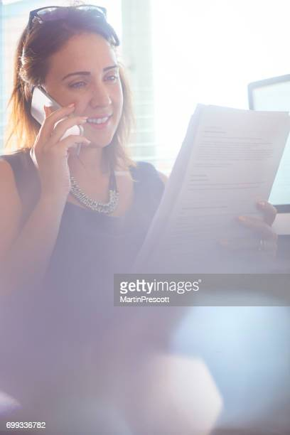 Smiling Businesswoman on the phone in her office