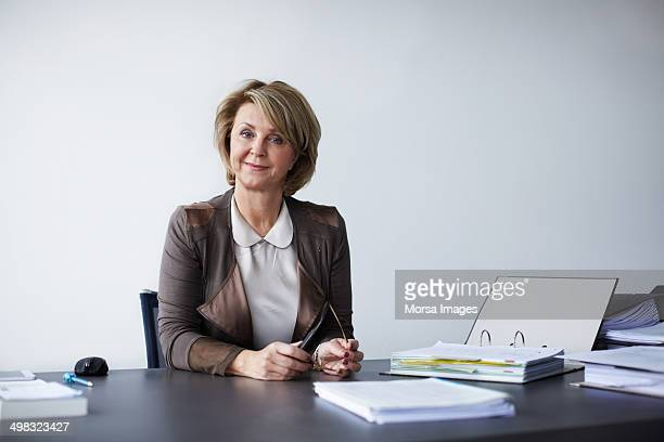 Smiling businesswoman sitting at desk