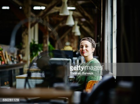 Smiling businesswoman sitting at workstation