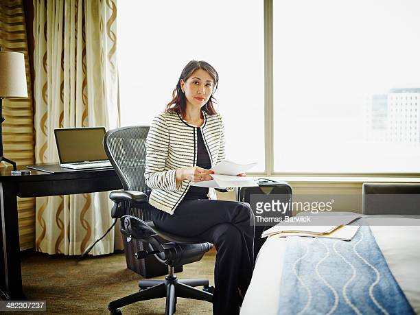 Smiling businesswoman sitting in hotel room