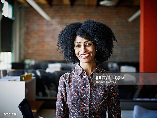 Smiling businesswoman standing in office