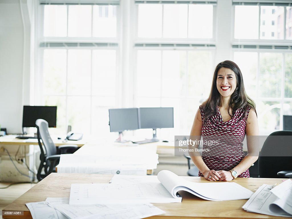 Smiling businesswoman standing in office : Stock Photo