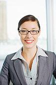 Smiling businesswoman wearing eyeglasses