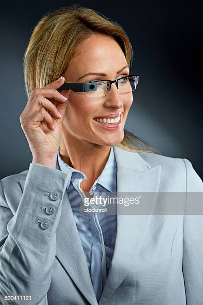 Smiling businesswoman wearing smart glasses