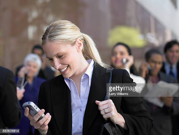 Smiling Businesswoman with Cell Phone