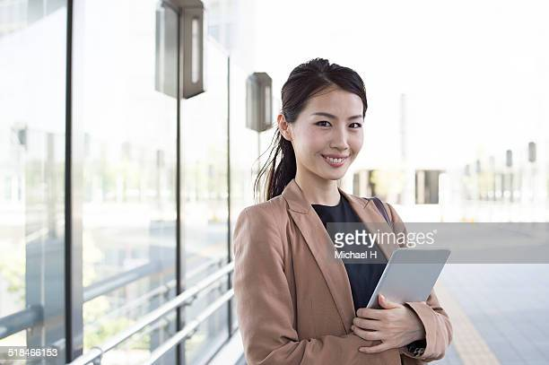 smiling businesswoman with digital tablet