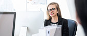 Smiling happy businesswoman white collar worker concentrating on working with desktop computer in office banner background