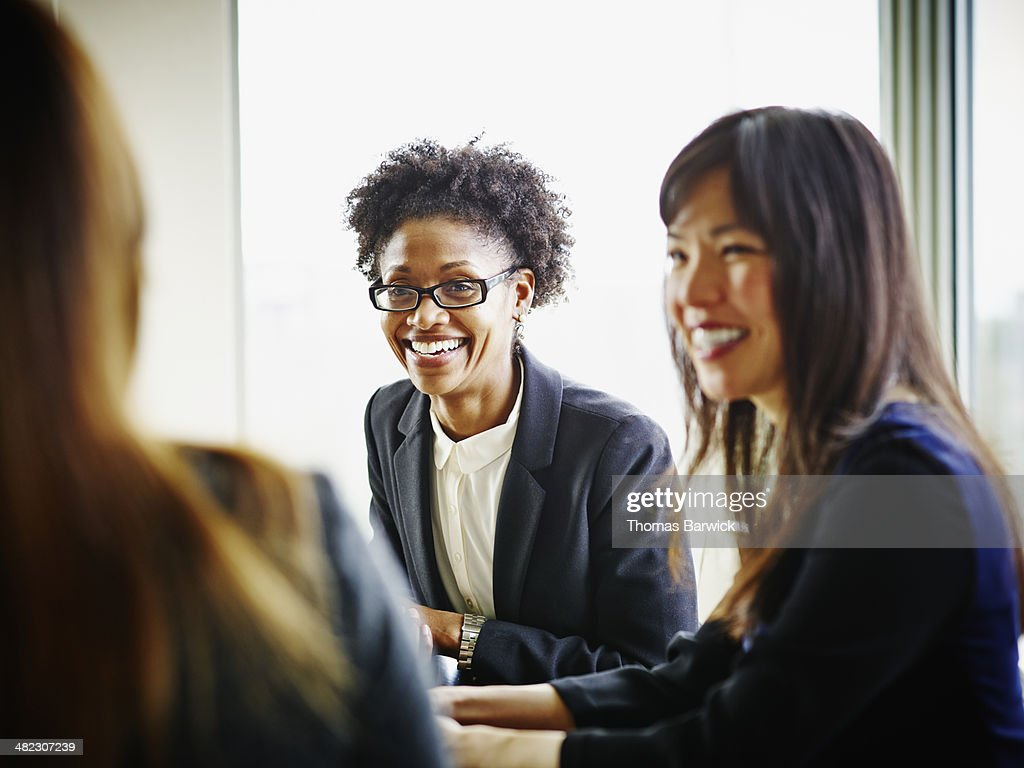 Smiling businesswomen discussing project