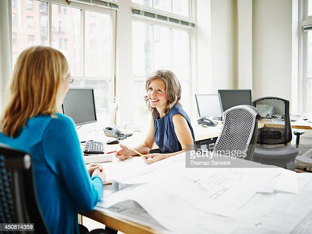 Smiling businesswomen in discussion in office